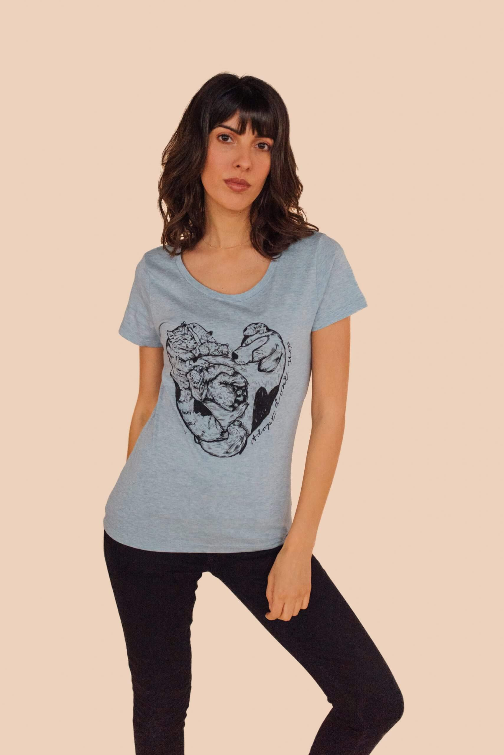 Vegan female model wearing blue organic tshirt with adopt dont shop statement graphic