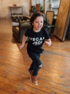 Model running wearing vegan jedi kids t-shirt