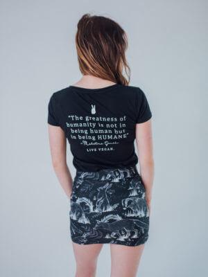 Vegan Model wearing all over animal print skirt back view