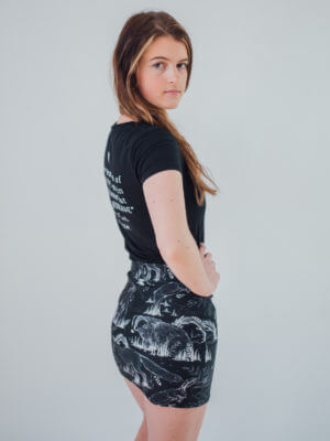Vegan Model Wearing All over Animal print skirt side view