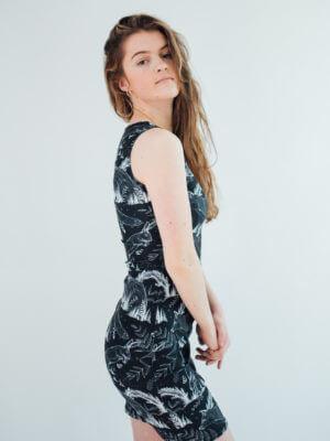 Vegan Model wearing wildlife dress side view