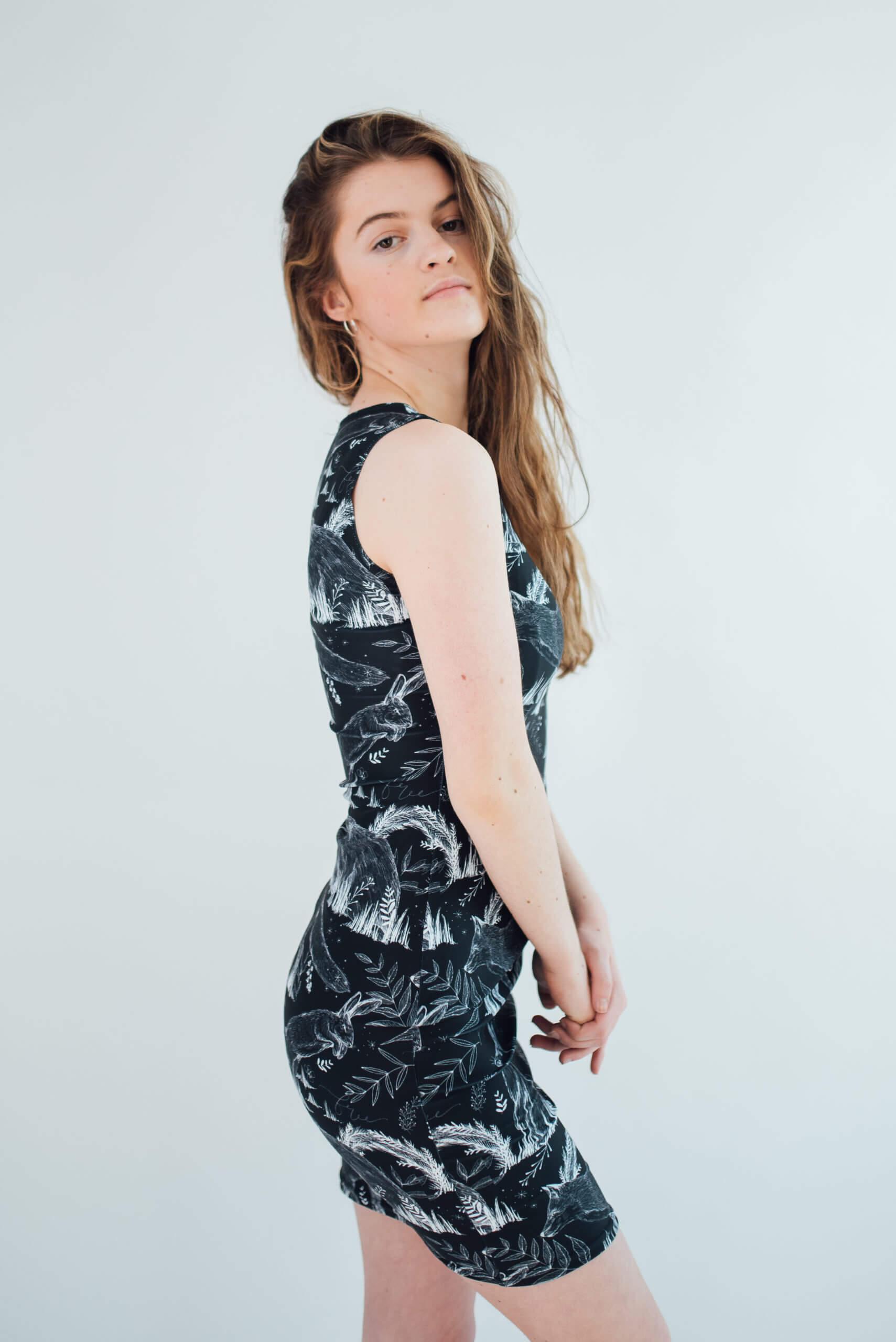 Vegan Model wearing wildlife dress side view