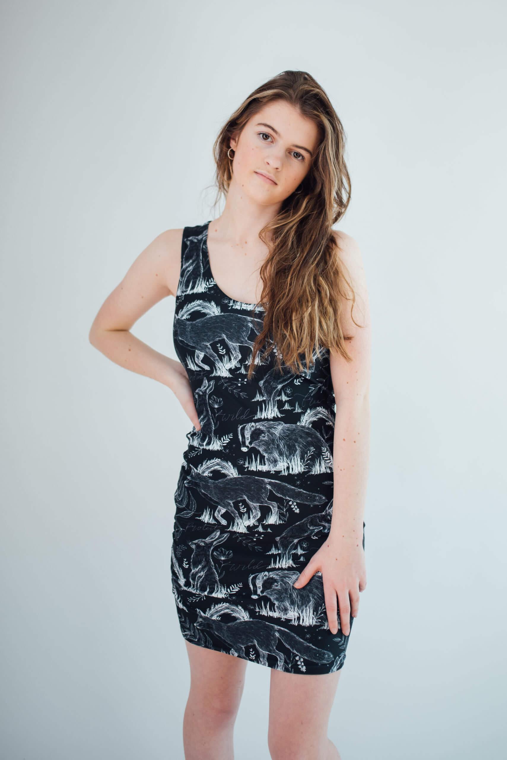 Vegan Model Angel wearing all over print wildlife dress